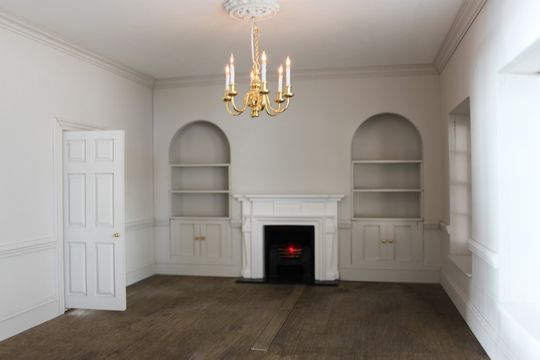Bespoke Regency dolls house shelved alcoves and window seats.