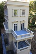 Bespoke Regency dolls house looking down on the portico and balcony.