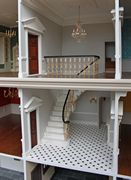Georgian dolls house with hand marbled staircase and grand crystal chandelier.