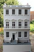 Georgian dolls house with contemporary open-plan basement .