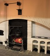 Georgian dolls house kitchen showing two types of cooking range that come fitted inside the inglenook arch: one would have been used for spit roasting.